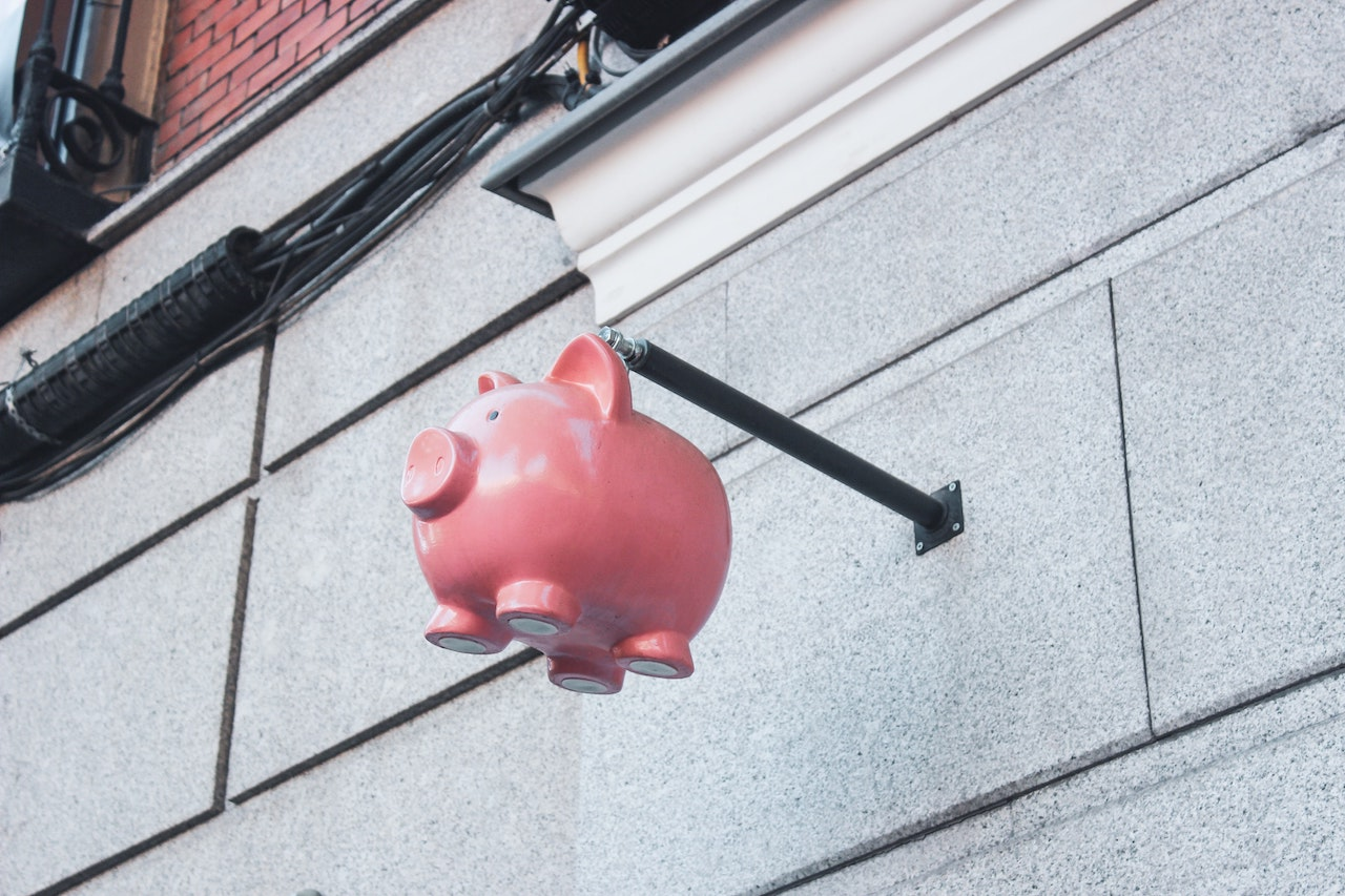 A piggybank hanging on a wall